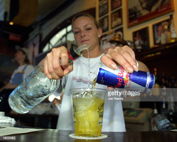Sloppy Joe''s Bar Tender Crystal Petersen mixes a Red Bull energy drink with vodka July 22 2001 in Key West FL The popular energy drink is now trendy...