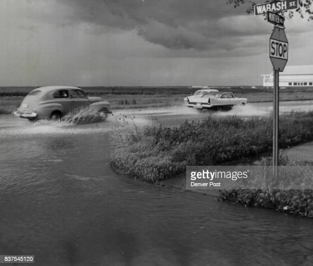 Sloppy Sailing in East Denver Cars churn up the water in a quickforming pond at Montview Blvd and Wabash St late Saturday afternoon after a brief...
