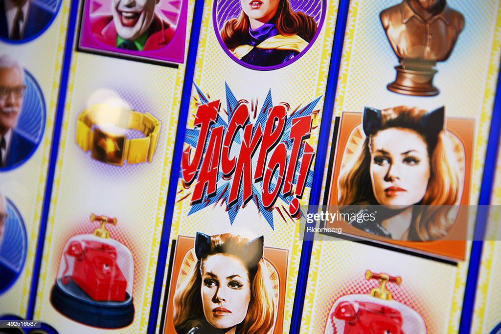 A slot machine reads 'Jackpot' at the Global Gaming Expo (G2E) inside the Venetian Macao resort and casino, operated by Sands China Ltd., a unit of Las Vegas Sands Corp., in Macau, China, on Tuesday, May 20, 2014. The gaming expo runs through May 22. Photographer: Brent Lewin/Bloomberg via Getty Images