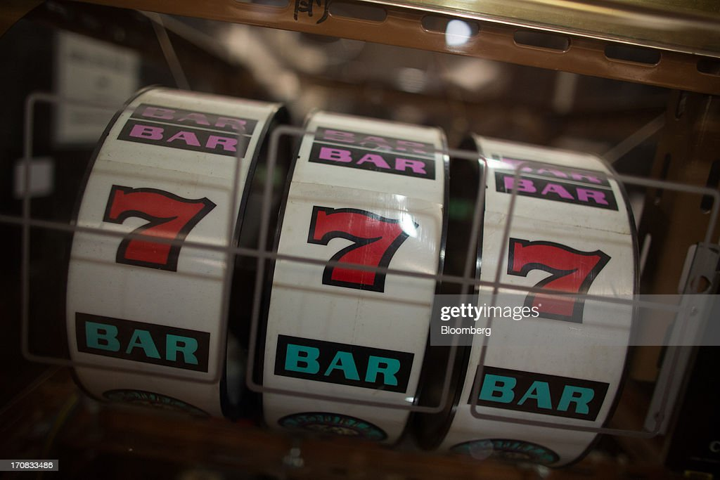 A slot machine used for training stands at the Macao Polytechnic Institute (MPI) Gaming Teaching and Research Centre in Macau, China, on Tuesday, June 18, 2013. Casino revenue in Macau, the only place in China where casino gambling is legal, rose 14 percent to a record of 304 billion patacas ($38 billion) in 2012. Photographer: Lam Yik Fei/Bloomberg via Getty Images