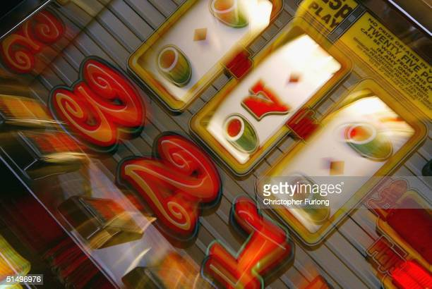 Slot machines are seen in an amusement arcade following the announcement of the newly proposed gambling bill which will effect casinos and amusement...