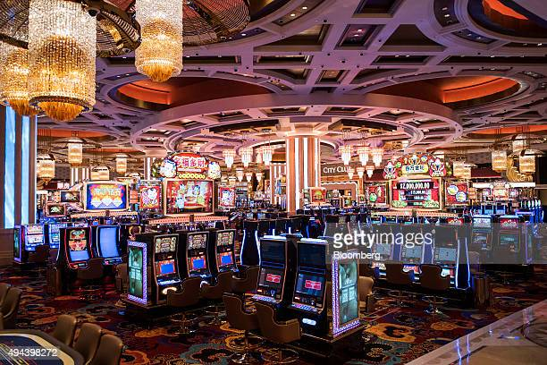 Slot machines stand on the gaming floor of the casino at the Studio City casino resort developed by Melco Crown Entertainment Ltd ahead of the grand...