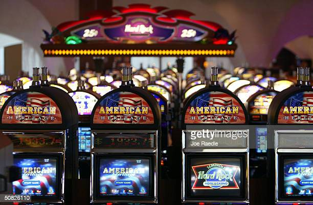 Slot machines wait for players May 11 2004 during the grand opening for the Seminole Hard Rock Hotel and Casino in Hollywood Florida South Florida's...