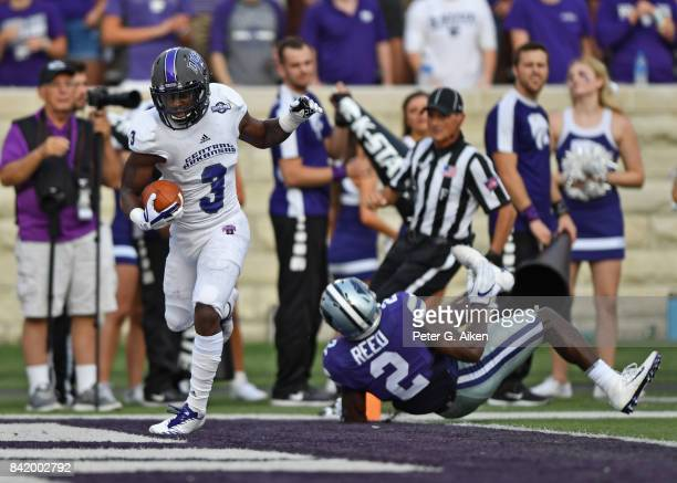 Slot receiver Brandon Cox 3 of the Central Arkansas Bears rushes in for a touchdown against defensive back DJ Reed of the Kansas State Wildcats...