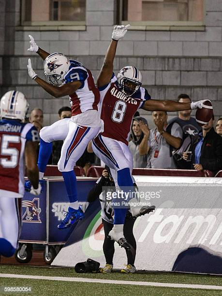 Slotback Nik Lewis of the Montreal Alouettes celebrates his touchdown with teammate wide receiver Kenny Stafford during the CFL game against the...
