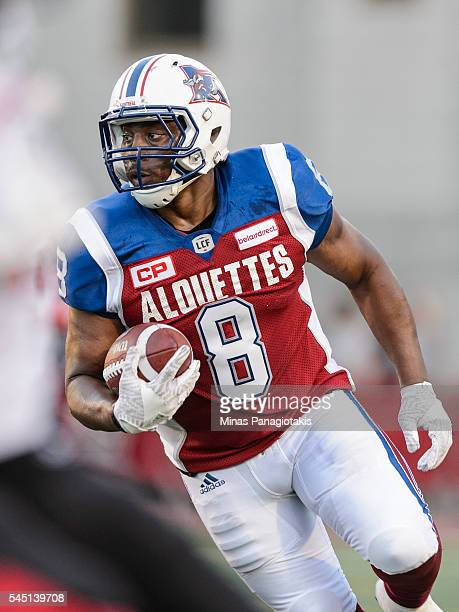 Slotback Nik Lewis of the Montreal Alouettes runs with the ball during the CFL game against the Ottawa Redblacks at Percival Molson Stadium on June...