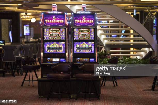 Slots machines stand on board the Ovation of the Seas Quantumclass cruise ship operated by Royal Caribbean Cruises Ltd at the Kai Tak Cruise Terminal...