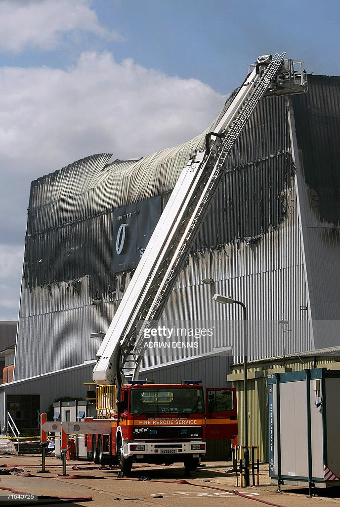 A fire truck stands beside the large James Bond sound stage at Pinewood Studios near Slough, some 30 miles west of London, 30 July 2006. Fire broke out at the studio where the latest James Bond movie, Casino Royale, was being filmed. The fire has reportedly destroyed the stage, one of the largest in Europe, which had been transformed into a replica of Venice where the latest Bond movie is being filmed. A worker at the studio reportedly said, the filming of the movie had finished and the stage was being de-rigged.