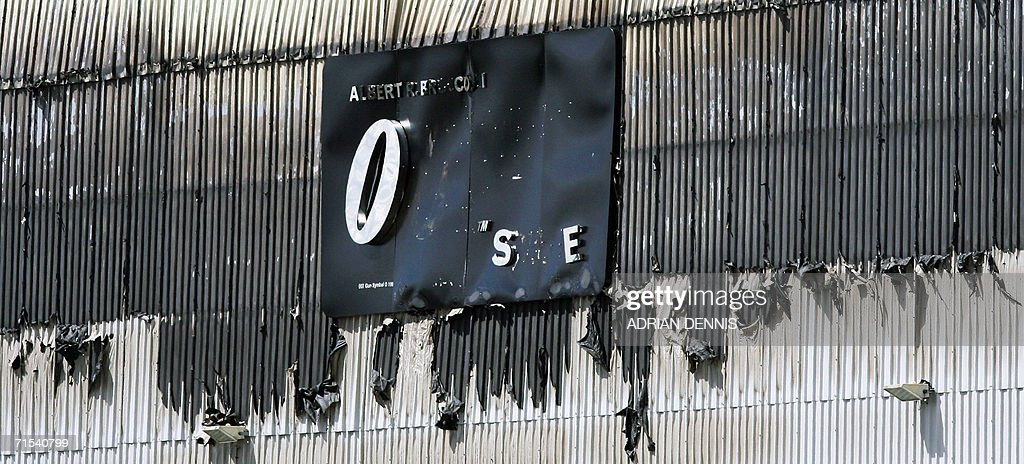 The wall and sign of The large James Bond sound stage showing heavy damage after fire destroyed the set at Pinewood Studios near Slough, some 30 miles west of London 30 July 2006. Fire broke out at the studio where the latest James Bond movie, Casino Royale, was being filmed. The fire has reportedly destroyed the stage, one of the largest in Europe, which had been transformed into a replica of Venice where the latest Bond movie is being filmed. A worker at the studio reportedly said, the filming of the movie had finished and the stage was being de-rigged.