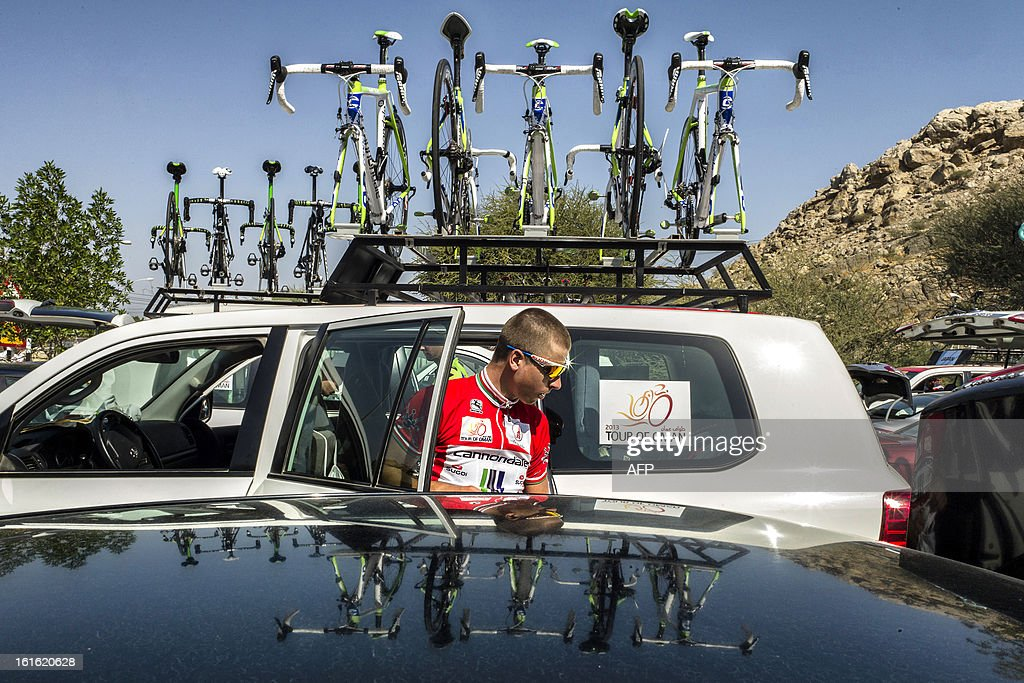 Slovak cyclist Peter Sagan of Cannondale (red jersey, actual leader) prepares before the third stage of the Tour of Oman, from Nakhal Fort to Wadi Dayqah Dam, on February 13, 2013, in Oman. The six-stage race, which follows the Tour of Qatar, won by Britain's Mark Cavendish last week, culminates on February 16 at Matra Corniche. AFP PHOTO / JEFF PACHOUD