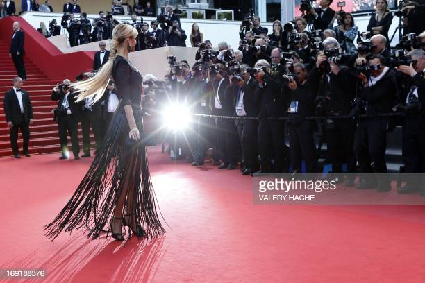 Slovak model Adriana Karembeu poses on May 21 2013 as she arrives for the screening of the film 'Behind the Candelabra' presented in Competition at...
