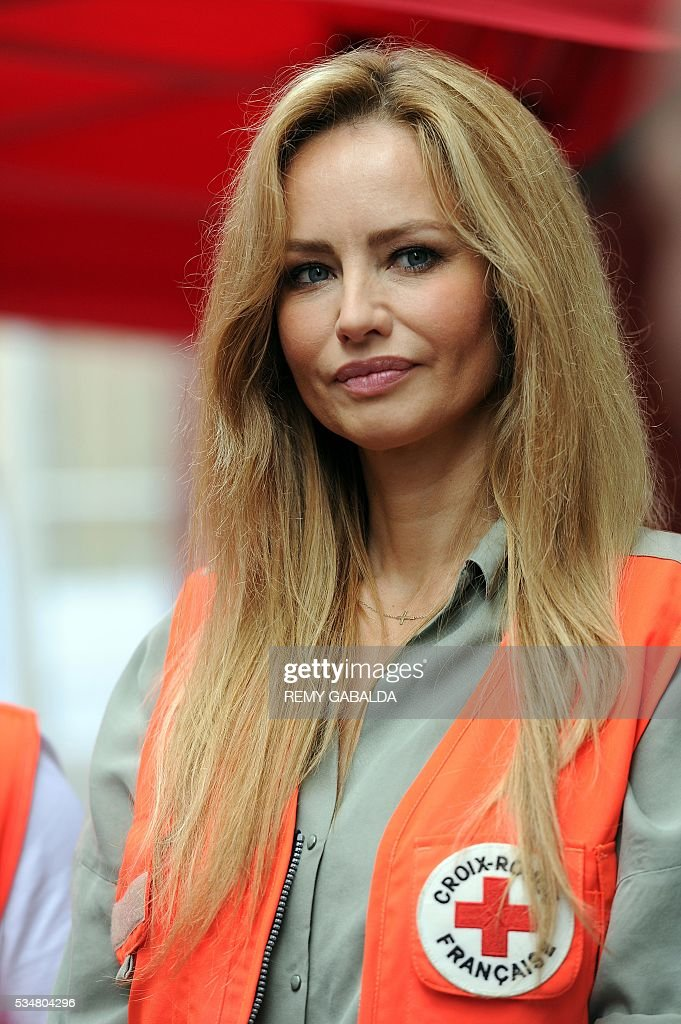Slovak model and ambassador for the French Croix Rouge (Red Cross) Adriana Karembeu looks on as she collects money for the Red Cross in Toulouse, southern France, on May 28, 2016 as part of the Red Cross national days which aims to present the actions of the charity. / AFP / REMY