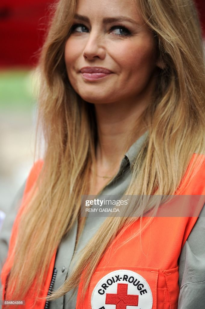 Slovak model and ambassador for the French Croix Rouge (Red Cross) Adriana Karembeu looks on during the inauguration of an health centre for the needy on May 28, 2016 at the hospital Lagrave in Toulouse, southern France, as part of the Red Cross national days which aims to present the actions of the charity. / AFP / REMY