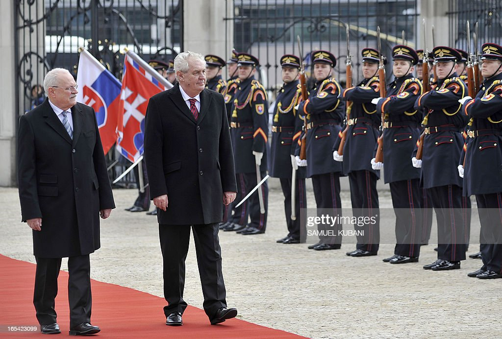 Slovak President Ivan Gasparovic (L) and his Czech counterpart Milos Zeman inspect a honor guard on April 4, 2013 as part of their official meeting in Bratislava. New elected Czech President Milos Zeman is on his first official two-day visit to Slovakia.