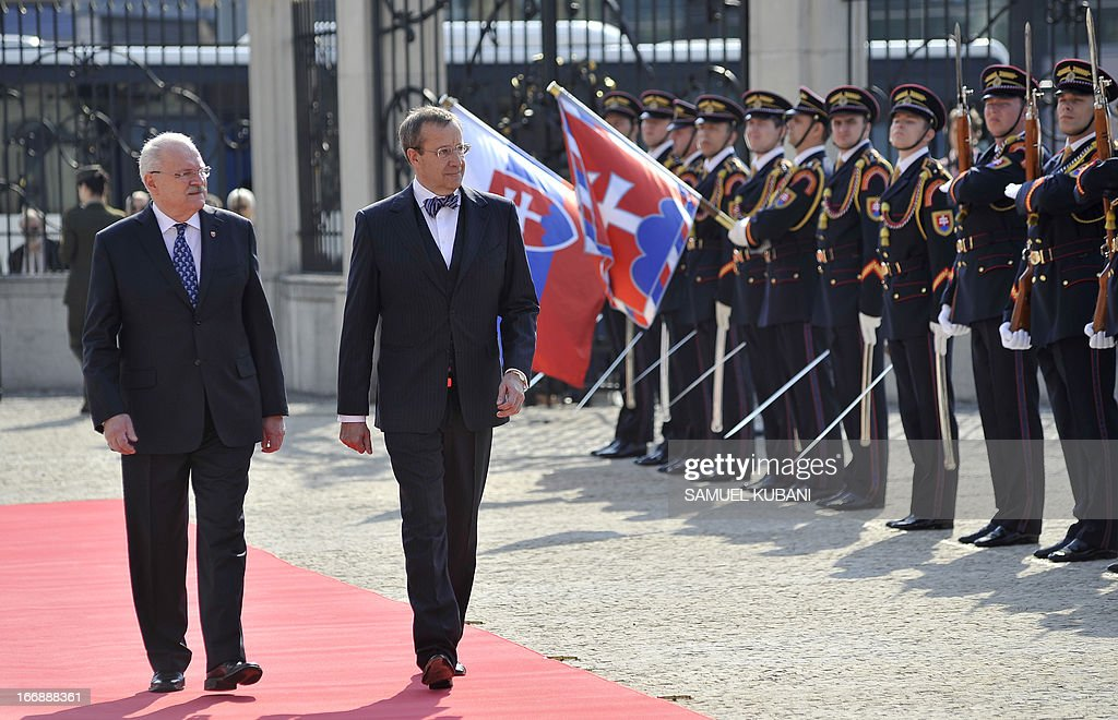 Slovak President Ivan Gasparovic (L) and his Estonian counterpart Toomas Hendrik Ilves inspect an honor guard on April 18, 2013 as part of their official meeting in Bratislava. Ilves pays a two day visit to Slovakia and will attend at GLOBSEC 2013 international security forum in Bratislava (18-19 April).
