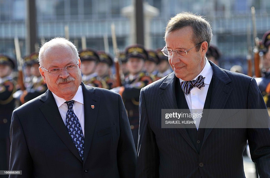 Slovak President Ivan Gasparovic (L) and his Estonian counterpart Toomas Hendrik Ilves inspect an honor guard on April 18, 2013 as part of their official meeting in Bratislava. Ilves pays a two day visit to Slovakia and will attend at GLOBSEC 2013 international security forum in Bratislava (18-19 April). AFP PHOTO/SAMUEL KUBANI