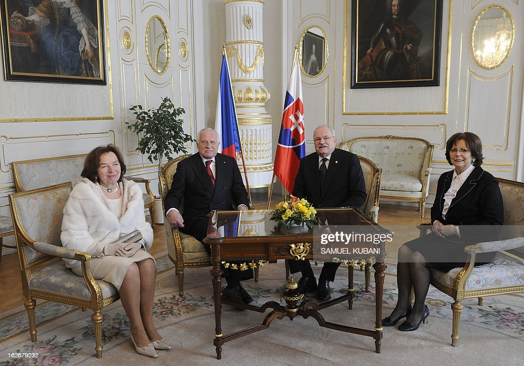 Slovak President Ivan Gasparovic (2nd R) and his wife Silvia (R) pose with Czech President Vaclav Klaus (2nd L) and his wife Livia (L) during a meeting on February 26, 2013 in Bratislava. Klaus is on a two-day official visit to Slovakia.