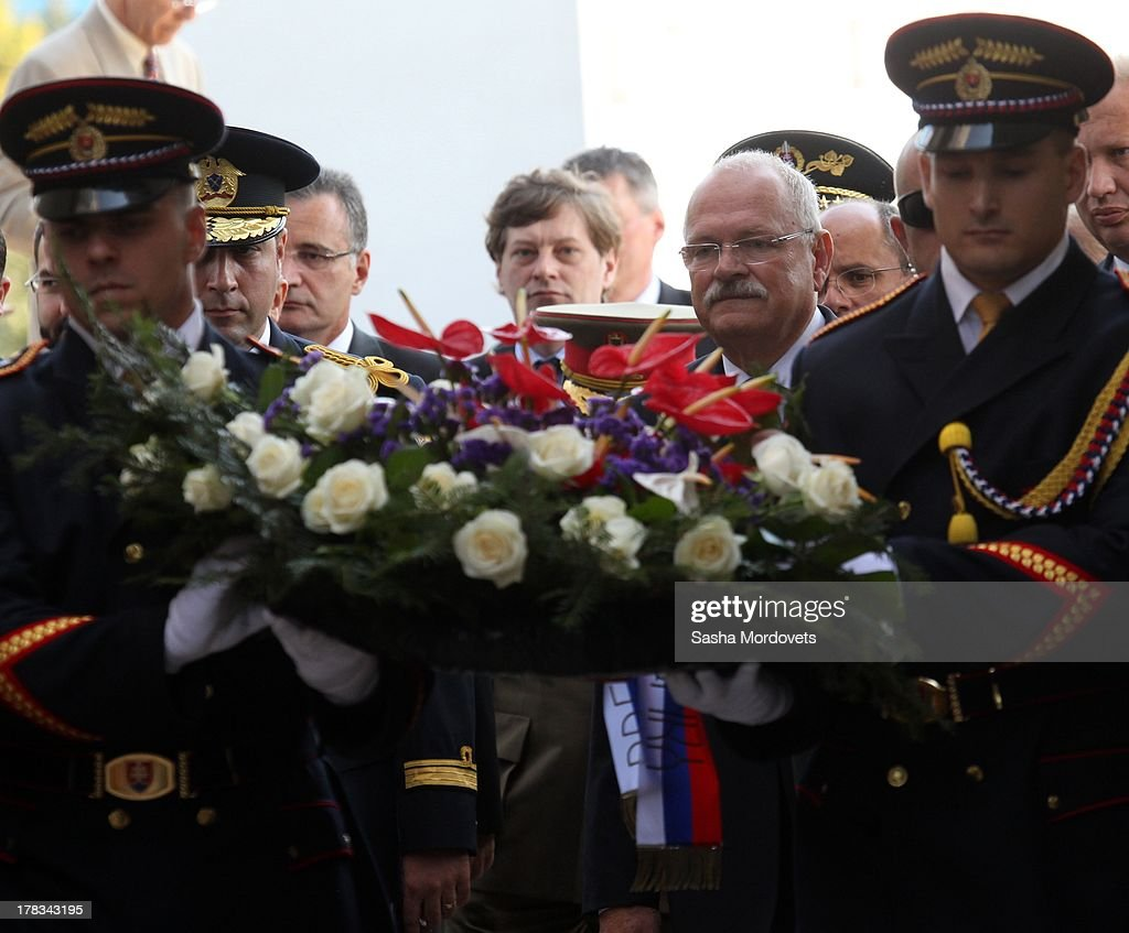 Slovak President <a gi-track='captionPersonalityLinkClicked' href=/galleries/search?phrase=Ivan+Gasparovic&family=editorial&specificpeople=555593 ng-click='$event.stopPropagation()'>Ivan Gasparovic</a> attends a wreath laying ceremony during the 69th anniversary celebrations of the Slovak National Uprising on August 29, 2013 in Banska Bystrica, Slovakia. Romanian President <a gi-track='captionPersonalityLinkClicked' href=/galleries/search?phrase=Traian+Basescu&family=editorial&specificpeople=542324 ng-click='$event.stopPropagation()'>Traian Basescu</a> is on an official two-day visit to Slovakia.