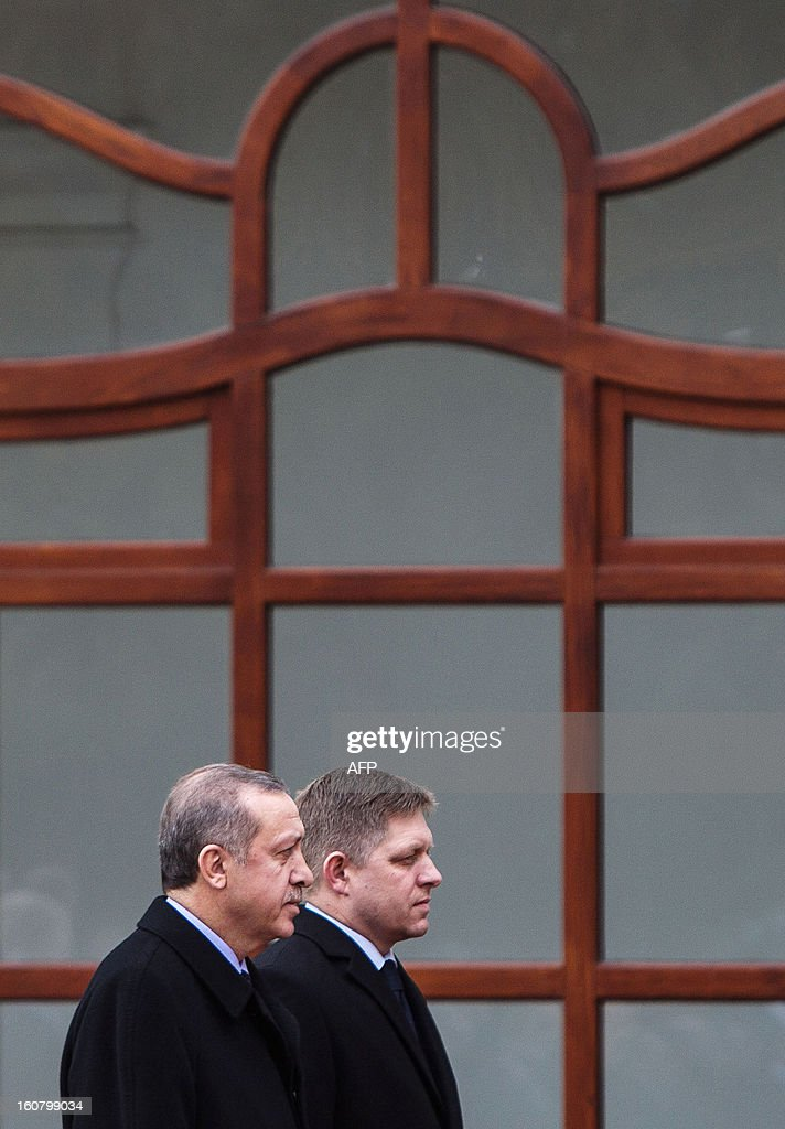 Slovak Prime Minister Robert Fico (R) and his Turkish counterpart Recep Tayyip Erdogan (L) review a guard of honor on February 6, 2012 in Bratislava, Slovakia.