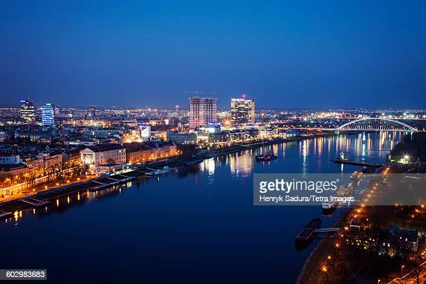 Slovakia, Bratislava, Illuminated cityscape and river at night