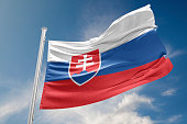 Slovakia flag is waving at a beautiful and peaceful sky in day time while sun is shining. 3D Rendering