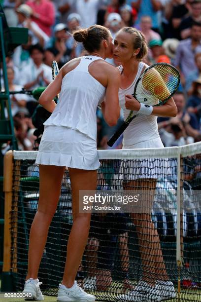 Slovakia Magdalena Rybarikova kisses Czech Republic's Karolina Pliskova at the net after Rybarikova won their women's singles second round match on...