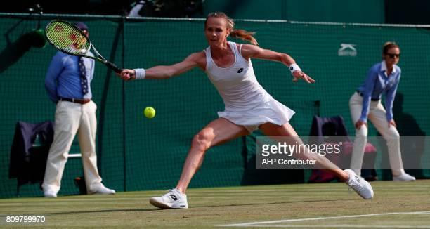 Slovakia Magdalena Rybarikova returns against Czech Republic's Karolina Pliskova during their women's singles second round match on the fourth day of...