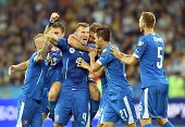 Slovakia players celebrate after defeating Ukraine on September 8 2014 during a UEFA Euro 2016 qualifier football match against Slovakia in Kiev AFP...