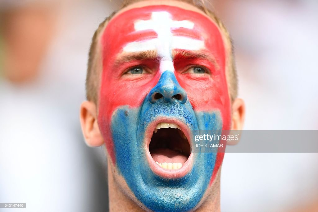 A Slovakia supporter cheers for his team ahead of the Euro 2016 round of 16 football match between Germany and Slovakia at the Pierre-Mauroy stadium in Villeneuve-d'Ascq near Lille on June 26, 2016. / AFP / Joe KLAMAR