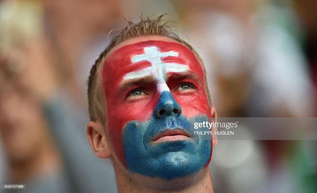 A Slovakia supporter looks on during Euro 2016 round of 16 football match between Germany and Slovakia at the Pierre-Mauroy stadium in Villeneuve-d'Ascq, near Lille, on June 26, 2016. / AFP / PHILIPPE