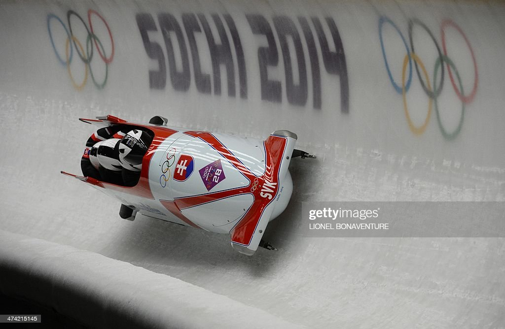 Slovakia-1 four-man bobsleigh, pilot Milan Jagnesak, pushman Petr Narovec, pushman Lukas Kozienka and brakeman Juraj Mokras compete in the Bobsleigh Four-man Heat 2 at the Sanki Sliding Center during the Sochi Winter Olympics on February 22, 2014.