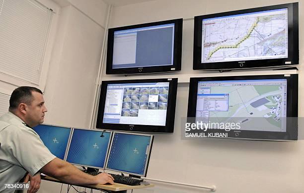 Slovakian border policeman looks at the monitoring system of the Slovakian Ukrainian border in Vysne Nemecke 500 km from the capital Bratislava 16...