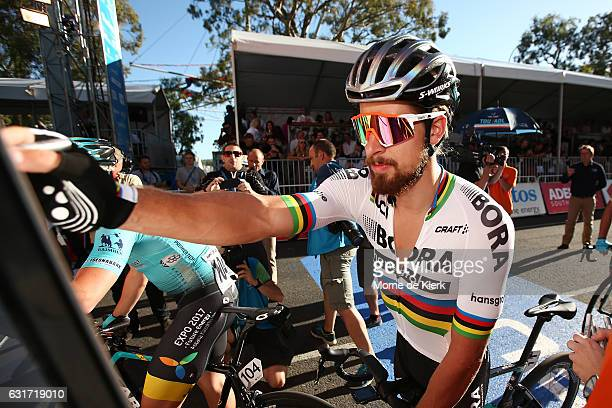 Slovakian cyclist Peter Sagan of the Bora Hansgrohe team signs on before the start of the People's Choice Classic street race a preview race to the...