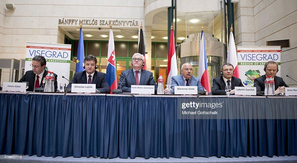 Slovakian Foreign Minister Miroslav Lajcak, German Foreign Minister <a gi-track='captionPersonalityLinkClicked' href=/galleries/search?phrase=Frank-Walter+Steinmeier&family=editorial&specificpeople=603500 ng-click='$event.stopPropagation()'>Frank-Walter Steinmeier</a>, Hungarian Foreign Minister <a gi-track='captionPersonalityLinkClicked' href=/galleries/search?phrase=Janos+Martonyi&family=editorial&specificpeople=2589439 ng-click='$event.stopPropagation()'>Janos Martonyi</a>, Czech Republic's Foreign Minister Lubomir Zaoralek and the deputy minister of state of Polands Foreign Ministry Artur Nowak-Far, (L-R) during a press conference on March 13, 2014 in Budapest, Hungary. German Foreign Minister <a gi-track='captionPersonalityLinkClicked' href=/galleries/search?phrase=Frank-Walter+Steinmeier&family=editorial&specificpeople=603500 ng-click='$event.stopPropagation()'>Frank-Walter Steinmeier</a> meets due to crisis in Ukraine with his counterparts from Hungary, Poland, Slovakia and Czech Republic.