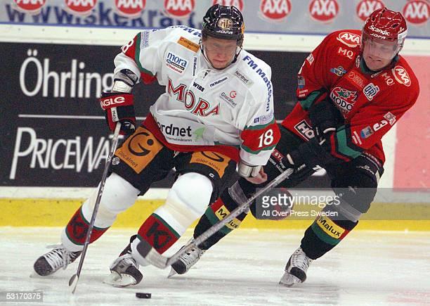 Slovakian ice hockey player Marian Hossa of Mora skates the puck around Mattias Timander of MoDo during a game in the Swedish Elitserien hockey...