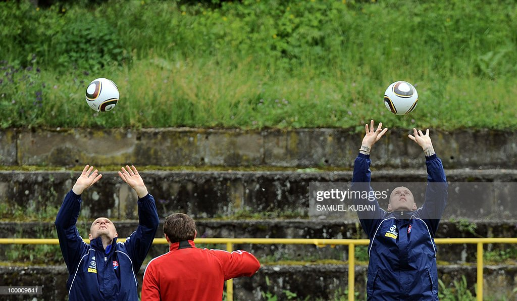 Slovakian national football players Martin Jakubko (L) and Martin Skrtel (R) play balls during a training session on May 20, 2010, at their training camp in Piestany, prior to the FIFA World cup 2010 held in South Africa.