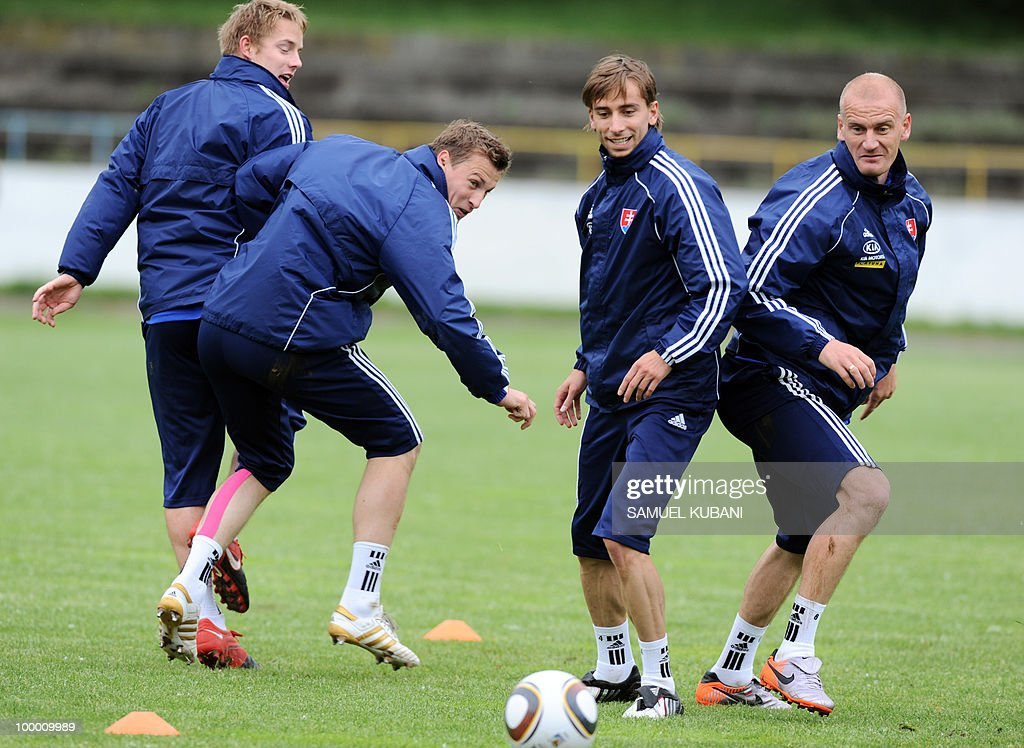 Slovakian national football players (L to R) Tomas Hubocan, Jan Durica, Dusan Svento and Miroslav Karhan play with ball during a training session on May 20, 2010, at their training camp in Piestany, prior to the FIFA World cup 2010 held in South Africa.