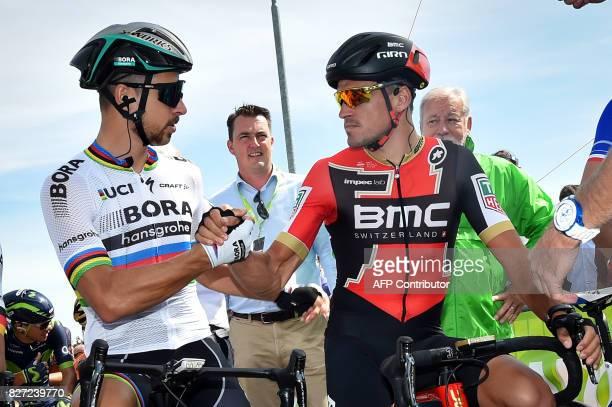Slovakian Peter Sagan of BoraHansgrohe and Belgian Greg Van Avermaet of BMC Racing Team shake hands at the start of the first stage of the BinckBank...