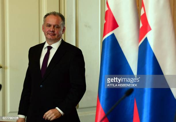 Slovakian President Andrej Kiska arrives at the Maria Theresia hall of the presidential palace in Budapest on December 5 2016 prior his joint press...