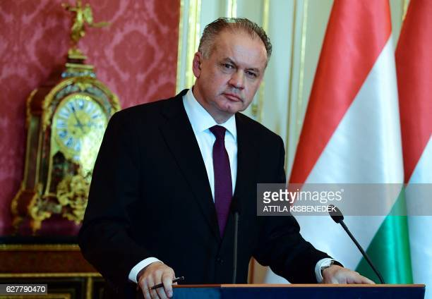 Slovakian President Andrej Kiska listens to a journalist' s question in the Maria Theresia hall of the presidential palace in Budapest on December 5...