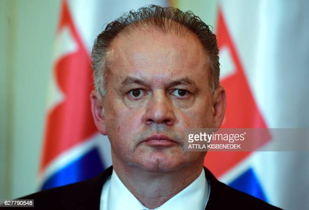 Slovakian President Andrej Kiska listens to a journalist's question in the Maria Theresia hall of the presidential palace in Budapest on December 5...