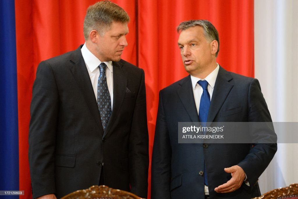 Slovakian Prime Minister Robert Fico (L) chats with his Hungarian counterpart Viktor Orban (R) in Delegation Hall of the parliament building in central Budapest on July 2, 2013 prior to their joint press conference. Orban meets with Fico for his one-day working visit.