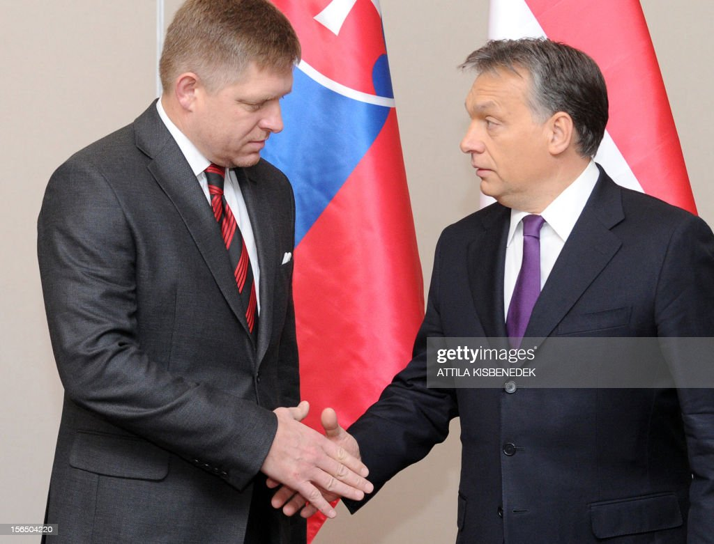 Slovakian Prime Minister Robert Fico (L) shakes hands with his Hungarian counterpart Viktor Orban (R) in the Hotel Corinthia in Budapest on November 16, 2012 prior to the Hungarian-Slovakian Economic Forum, organized by the Hungarian Chambers of Commerce.