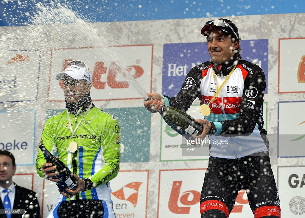 Slovakian second-placed Peter Sagan of Liquigas-Cannondale and Swiss first-placed Fabian Cancellara of team RadioShack-Leopard spray champagne as they celebrate on the podium after the 56th edition of cycling race E3 Prijs Vlaanderen Harelbeke, a 203km race from Harelbeke to Harelbeke, on March 22,2013. AFP PHOTO/BELGA/ERIC LALMAND -Belgium Out-