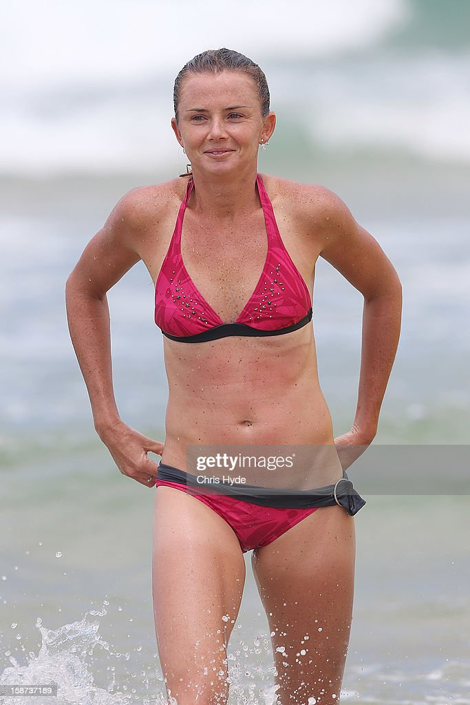 Slovakian tennis player <a gi-track='captionPersonalityLinkClicked' href=/galleries/search?phrase=Daniela+Hantuchova&family=editorial&specificpeople=201969 ng-click='$event.stopPropagation()'>Daniela Hantuchova</a> during a surf lesson with pro surfer Julian Wilson at Coolum Beach on December 27, 2012 in Sunshine Coast, Australia.