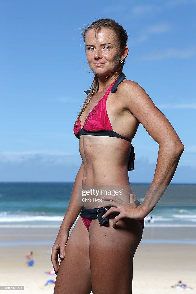 Slovakian tennis player <a gi-track='captionPersonalityLinkClicked' href=/galleries/search?phrase=Daniela+Hantuchova&family=editorial&specificpeople=201969 ng-click='$event.stopPropagation()'>Daniela Hantuchova</a> poses for a photograph after a surf lesson with pro surfer Julian Wilson at Coolum Beach on December 27, 2012 in Sunshine Coast, Australia.