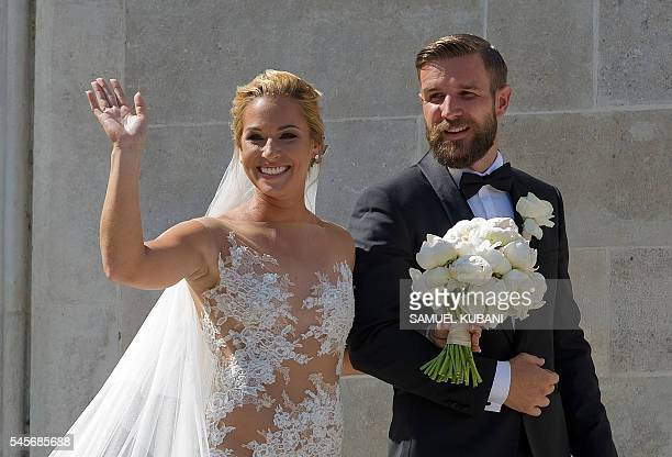 Slovakian tennis player Dominika Cibulkova and her husband Michal Navara laugh after their church wedding ceremony at the St Martin's Cathedral in...