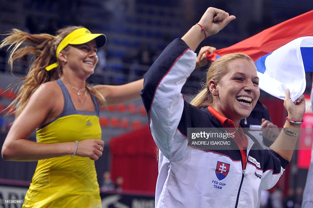 Slovakia's Daniela Hantuchova (L) and Dominika Cibulkova celebrate their team victory during the Fed cup World group first round tie tennis match between Serbia and Slovakia on February 10, 2013, in Nis.