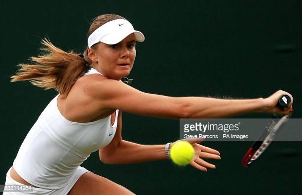 Slovakia's Daniela Hantuchova in action against Russia's Anastasia Pavlyuchenkova during The All England Lawn Tennis Championship at Wimbledon