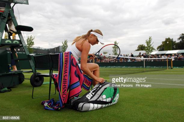 Slovakia's Daniela Hantuchova in action against Russia's Anastasia Pavlyuchenkova during The All England Lawn Tennis Championship at Wimbledon
